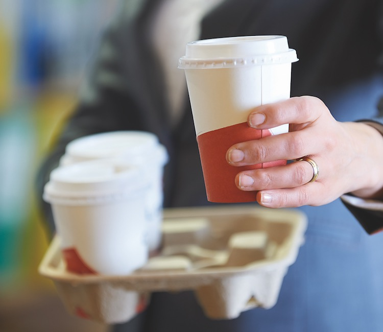 Businesswoamn With Takeaway Coffee